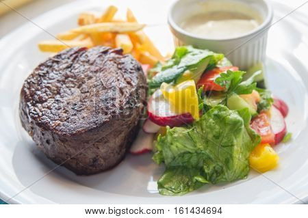 Filet Mignon With A Side Dish Of Vegetables