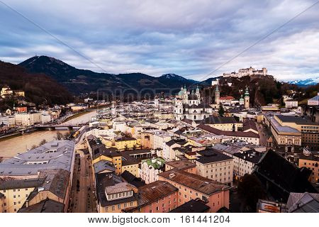Salzburg Austria. Aerial view of popular destination city in Austria - Salzburg at sunset. Castle and Cathedral with mountain at the background
