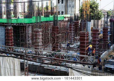 BANGKOK, THAILAND - 30 NOV - Real estate condominium site construction with workers at Bangkok city in Thailand on 30 November, 2016