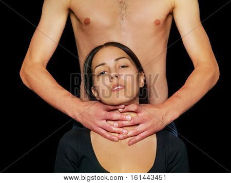 Home violence - young woman is choked by man's hand