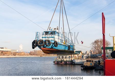MOSCOW, RUSSIA - NOVEMBER 11, 2016: State Unitary Enterprise Mosvodostok performs recovery vessels on coastal winter parking. The ship rises out of the water.