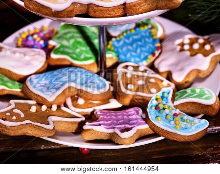 Colorful Christmas gingerbread cookies in Tiered Cookie Stand, close up.