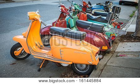 Row of classic vespa scooter parking by street on Febuary 16 2016 San Francisco USA