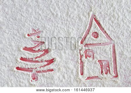 Christmas tree and home on flour background. White flour looks like snow. Top view