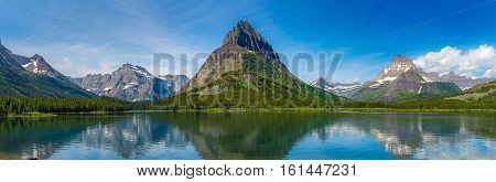 Swiftcurrent Lake And Reflection