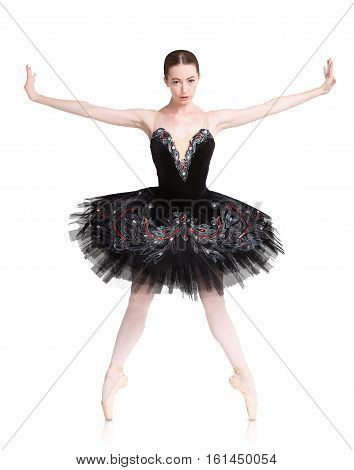 Classical Ballet dancer portrait. Beautiful graceful ballerine in black swan dress in releve ballet position isolated on white background. Ballet class concept.