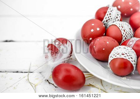 Red Easter Eggs On A White Plate