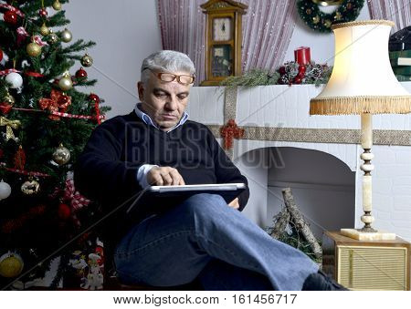 picture of a christmas theme.man on laptop surfing on net