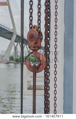 Orange hook hanging on a chain for watergate.