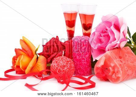 Two glasses candles and roses isolated on white background.