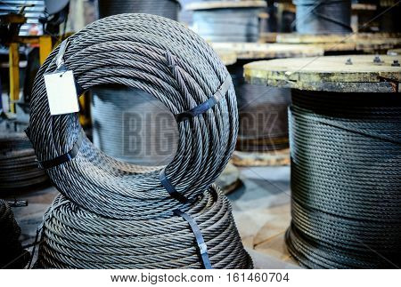 Ring of steel metal cargo cable. Industrial abstract background. Mockup.