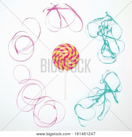 Colorful Lollipop Caramel On Stick With Ribbon On White Background, Top View, Flat Lay
