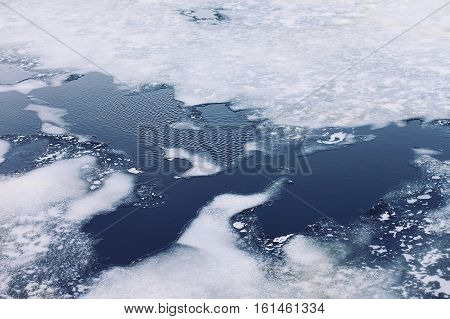 Cracked Ice Floes On A Frozen Sea, Winter Cold Background, Top View
