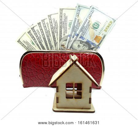 house model and dollar cash money in red wallet real estate concept