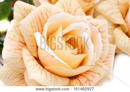 Yellow fabric roses horizontal close up picture.