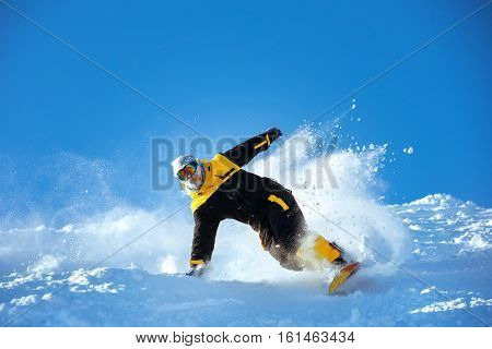 Snowboarder extreeme downhill with powder on ski slope. Sheregesh resort