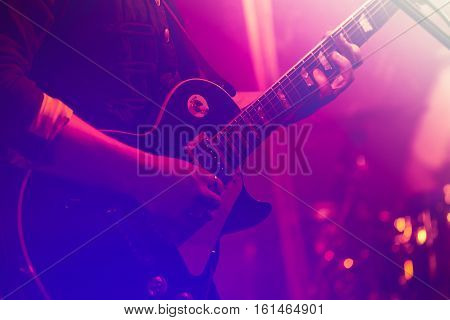Electric Guitar Player In Colorful Lights