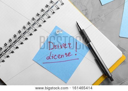 Notepad and note sticker with text. Driver license concept