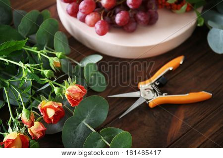 Flowers and berries for composition on wooden background