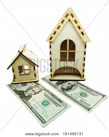 house model on dollar cash money background real estate concept