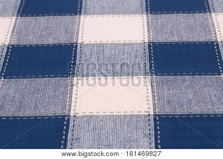 Checkered tablecloth texture as a background closeup picture.