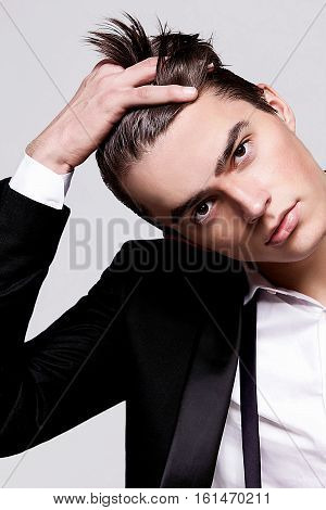 Man model in a dress coat smooth hair portrait