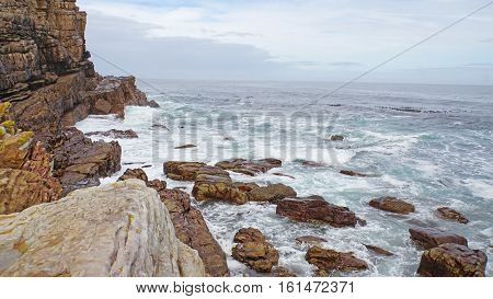 Rock landscape in South of the Cape Peninsula in South Africa, surf on the Atlantic coast near the Cape of Good Hope