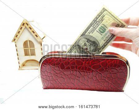 house model dollars cash money in wallet real estate concept