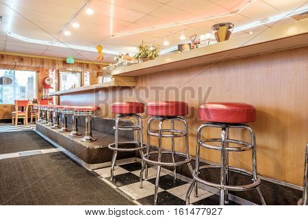Diner classic interior with counter and chairs