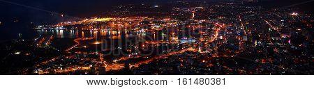 Panoramic portal infrastructure skyline illuminated at night during Porlwi by light