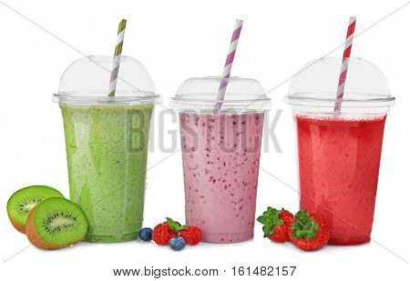 Tasty fruit cocktails in plastic cups isolated on white