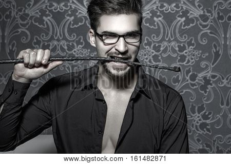 Smart handsome man bite whip at night bdsm