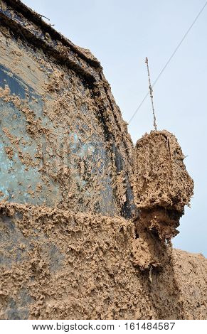 The dirt on the car after driving on a dirt road