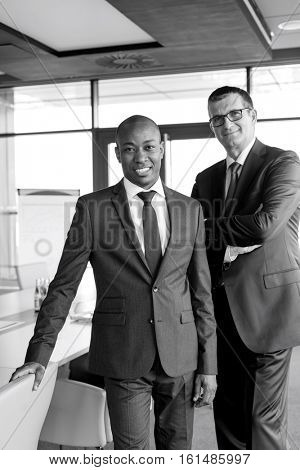 Portrait of confident businessmen standing together in office