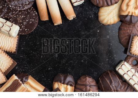 Cookies Assorted On Black Background. Delicious Morning Snacks For Breakfast, Brunch And Lunch. Appe