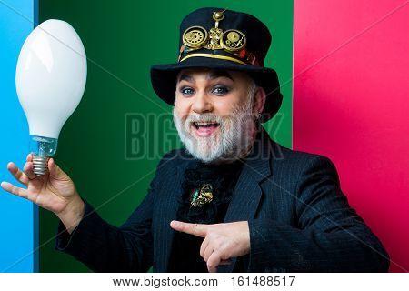 Smiling Man Holds Light Bulb