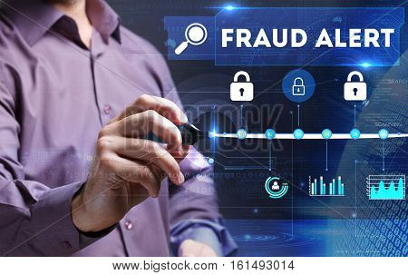 Technology, Internet, Business And Marketing. Young Business Person Sees The Word: Fraud Alert