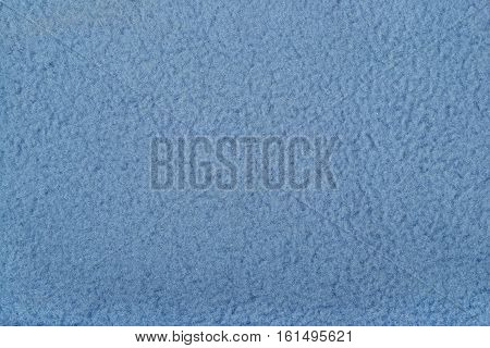 Blue polar fleece as background texture close up