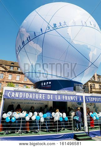 France Candidacy For World Fair 2025 - People Admiring Globe