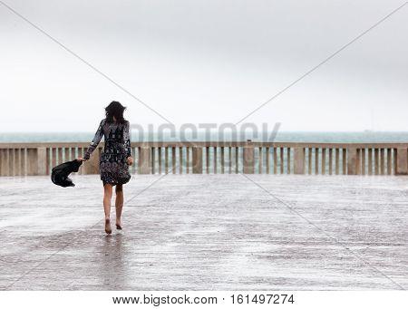 girl running in barefoot under the rain