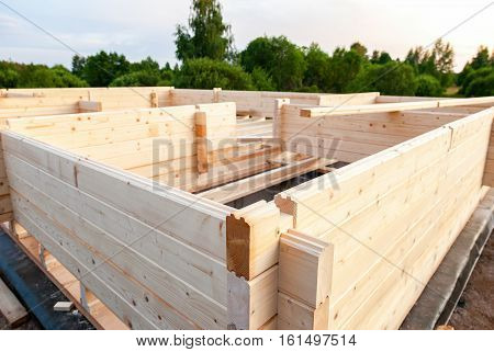 Construction of a new wooden house in summer day