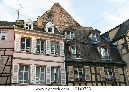 Photo of traditional half-timbered alsatian houses decorated for christmas