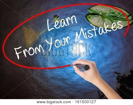 Woman Hand Writing Learn From Your Mistakes  With Marker Over Transparent Board