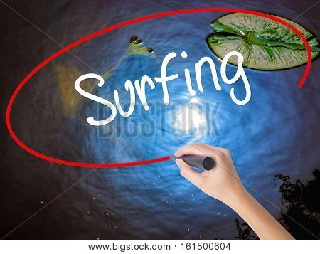 Woman Hand Writing Surfing  With Marker Over Transparent Board