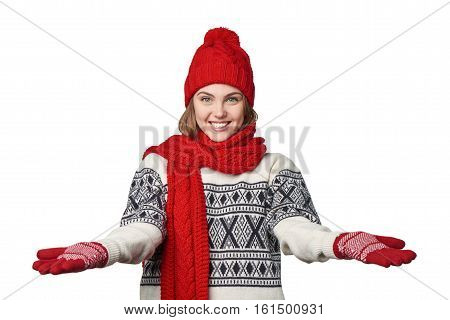 Happy hospitable young woman in warm winter clothing with opened arms salutating