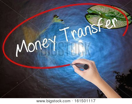 Woman Hand Writing Money Transfer  With Marker Over Transparent Board