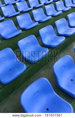 side view lines of blue stadium seats vertical composition