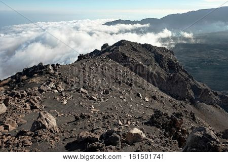 ridge Serra delle Concazze and low clouds on the Valle del Bove in Etna Park, Sicily