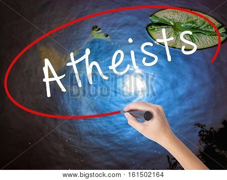 Woman Hand Writing Atheists With Marker Over Transparent Board