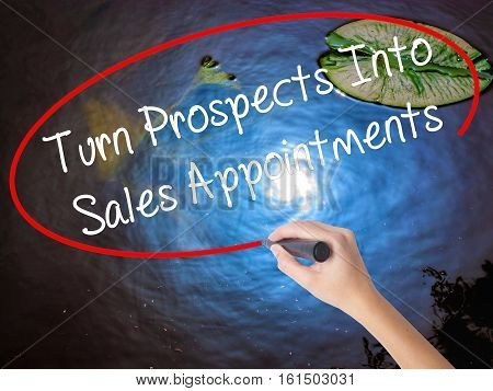 Woman Hand Writing Turn Prospects Into Sales Appointments  With Marker Over Transparent Board